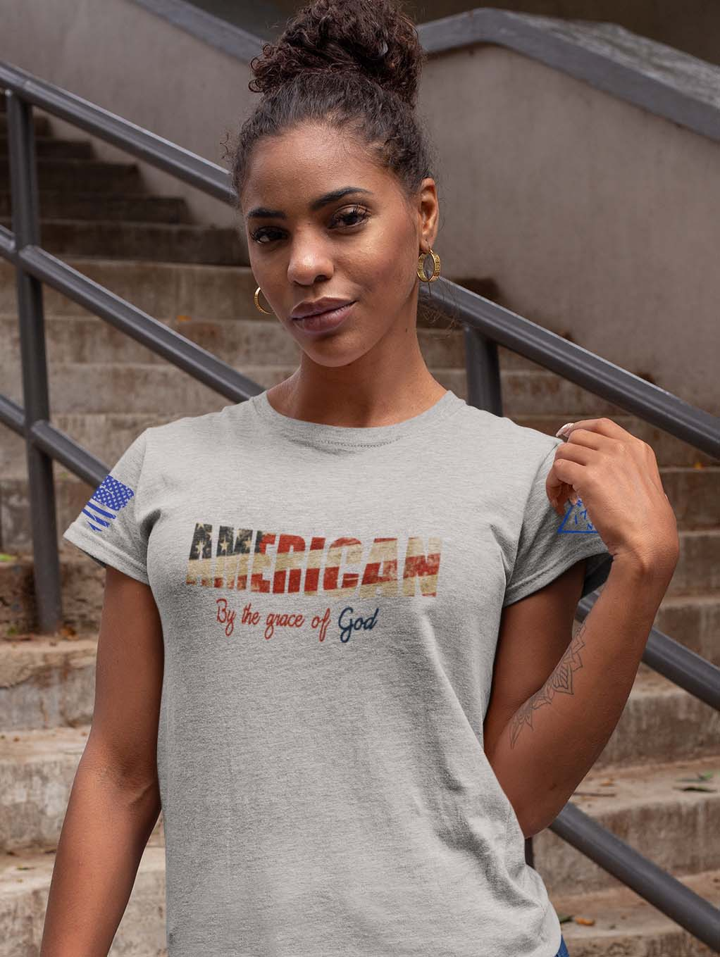 t-shirt by the grace of god on women's light heather grey
