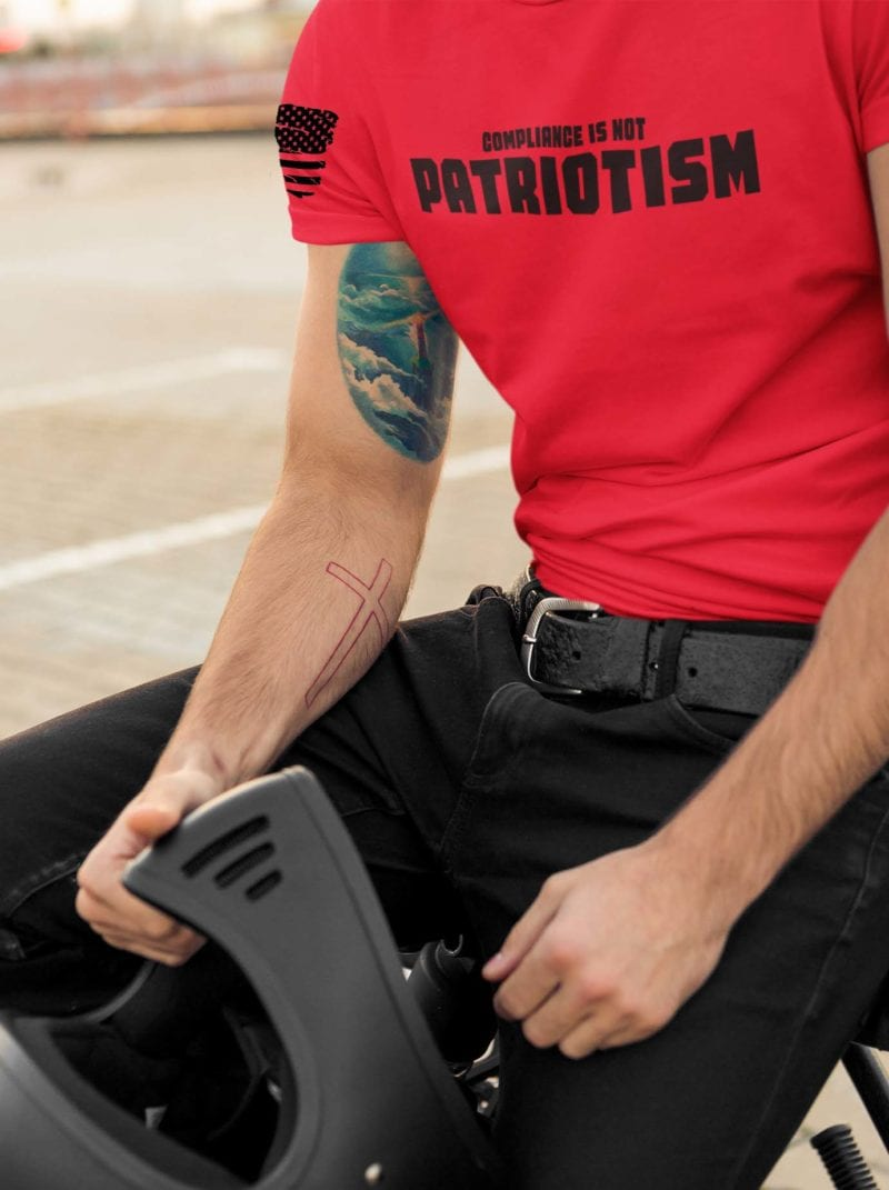 Compliance isn't Patriotism on men's red shirt